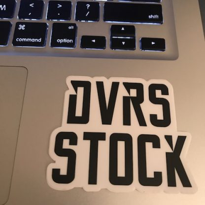 DVRS Stock Logo Sticker placed on top of laptop keyboard